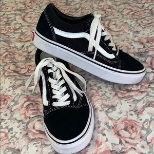 black and white Vans shoes